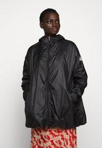 PYRENEX - WATER REPELLENT AND WINDPROOF - Waterproof jacket - black - 0