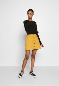MINKPINK - LAPS AROUND THE SUN MINI SKIRT - A-line skirt - golden yellow - 1