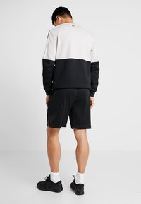 Reebok - TRAINING SHORTS - Sports shorts - black - 2