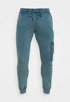 ESSENTIAL UTILITY - Tracksuit bottoms - marine blue