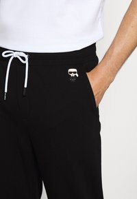 KARL LAGERFELD - PANTS - Tracksuit bottoms - black - 5