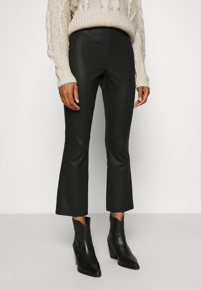TROUSERS IDA COATED - Trousers - black