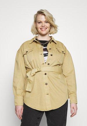 TIE WAIST SHACKET - Denim jacket - ivory