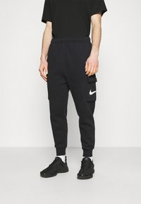 Nike Sportswear - COURT PANT - Tracksuit bottoms - black - 0