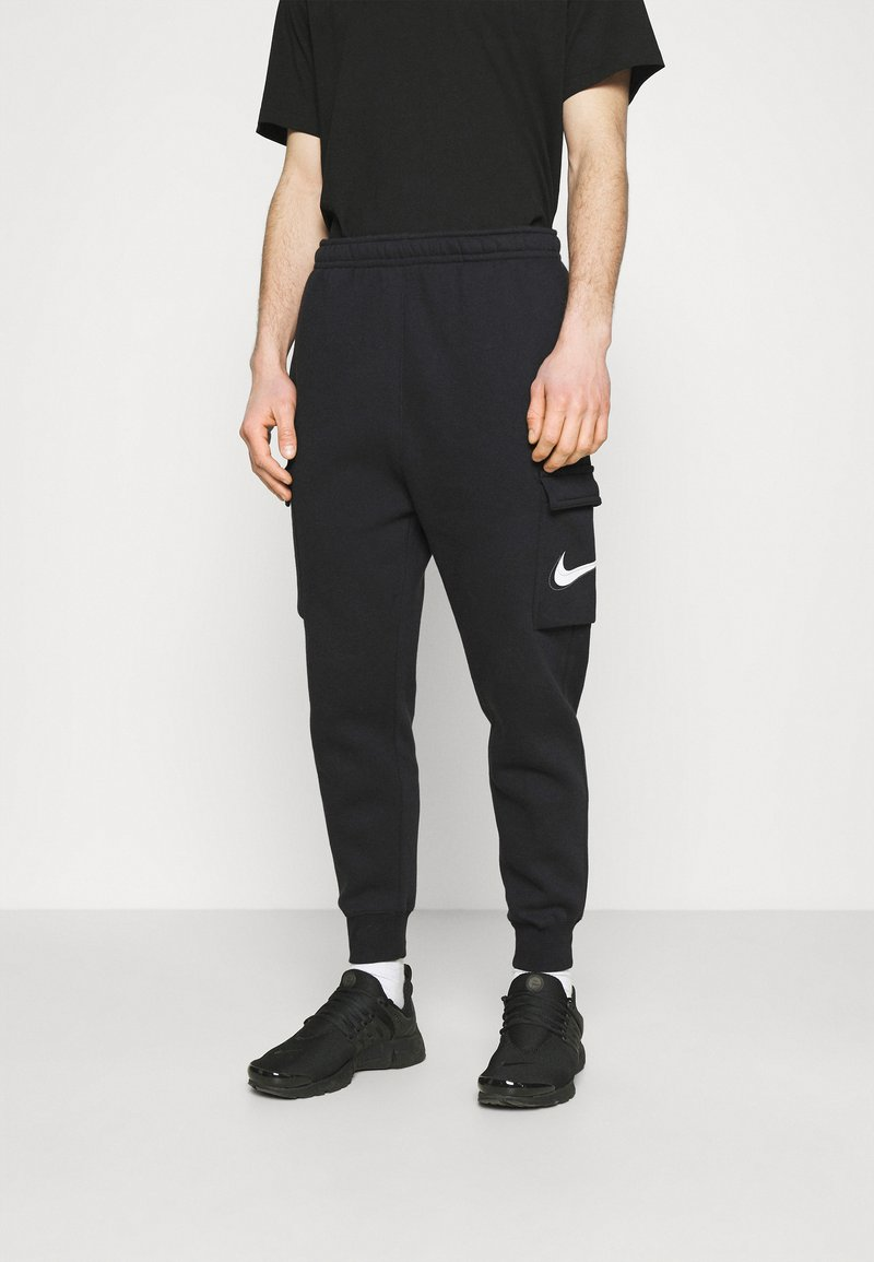 Nike Sportswear - COURT PANT - Trainingsbroek - black