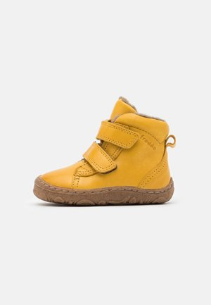 MINNI SLIM FIT UNISEX - Baby shoes - yellow