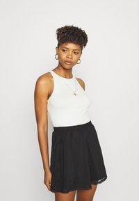 Even&Odd - BASIC - Mesh mini skirt - A-line skirt - black - 3