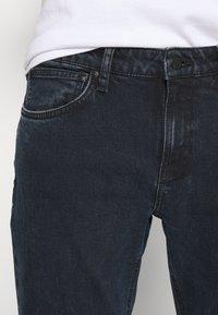 Nudie Jeans - UNISEX - Jeans slim fit - black ocean - 6