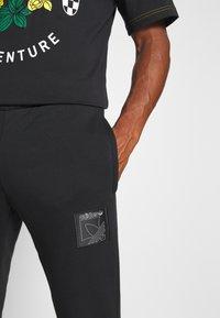 adidas Originals - ICON  - Tracksuit bottoms - black - 4