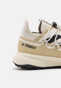 adidas Performance - TERREX VOYAGER 21 H.RDY  - Hiking shoes - chalk white/core black/alumina - 5