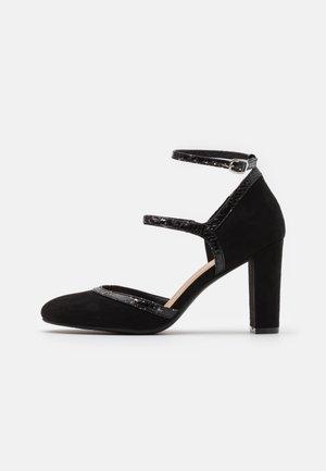 Højhælede pumps - black