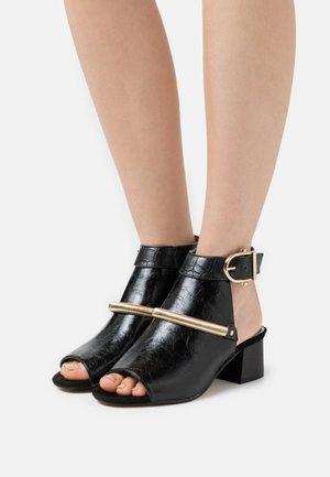 WIDE FIT BLOCK - Ankle cuff sandals - black