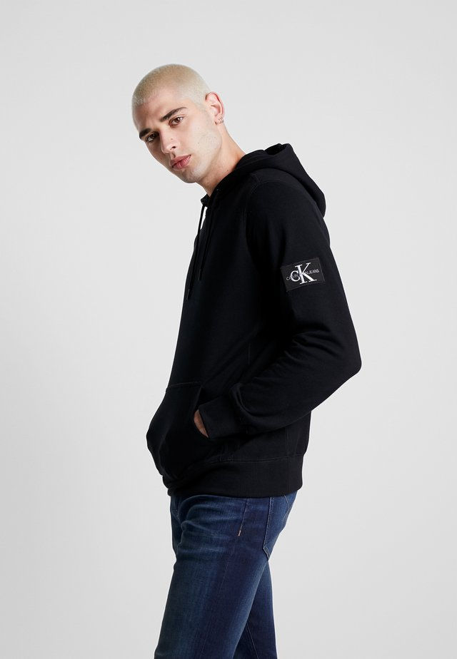 MONOGRAM SLEEVE BADGE HOODIE - Hoodie - black
