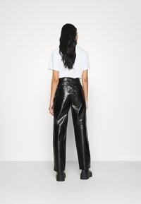 NA-KD - VINYL PANTS - Kalhoty - black - 2