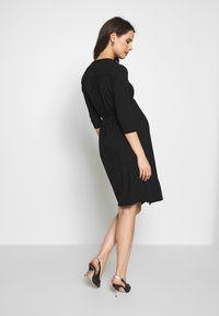 Cake Maternity - LONG SLEEVE WRAP DRESS - Vestito di maglina - black - 2
