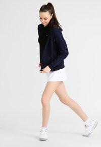 Lacoste Sport - WOMEN TENNIS - Zip-up hoodie - navy blue - 1