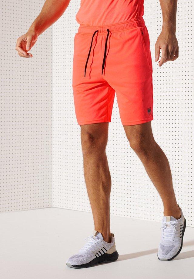 Korte sportsbukser - neon red