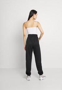 Nike Sportswear - TREND PANT - Tracksuit bottoms - black - 2