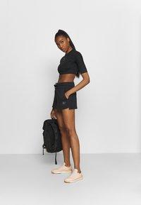 adidas by Stella McCartney - SWEAT SHORT - Sportovní kraťasy - black - 1