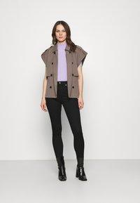 Calvin Klein Jeans - HIGH RISE ANKLE - Skinny džíny - denim black - 1