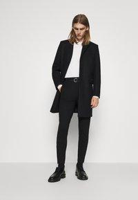 Bruuns Bazaar - POLITAN ZIP PANTS - Trousers - black - 1
