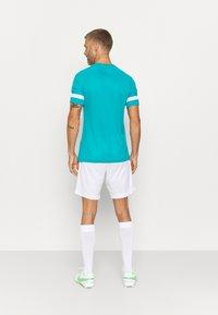 Nike Performance - ACADEMY 21 - T-shirt med print - aquamarine/white - 2