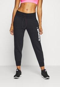 Nike Performance - Pantalones deportivos - black/white - 0