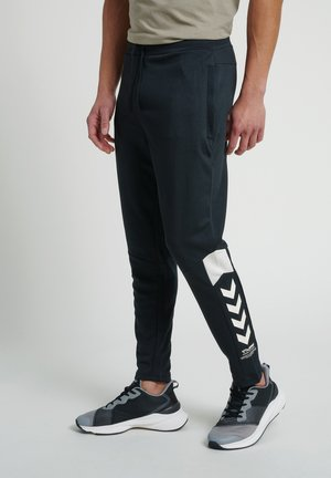 HMLALEC  - Tracksuit bottoms - black