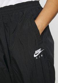 Nike Sportswear - AIR PANT - Tracksuit bottoms - black/white - 4