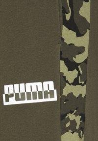Puma - CORE CAMO SWEATPANTS - Träningsbyxor - forest night - 6