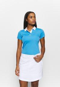 J.LINDEBERG - NOUR GOLF - Koszulka sportowa - ocean blue - 0