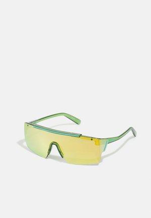DEIMOS UNSIEX - Sunglasses - transparent green