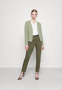 Vero Moda - VMFLASH BELT COLOR PANT - Trousers - ivy green - 1