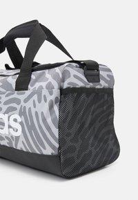 adidas Performance - DUFFEL - Sportovní taška - black/white - 4