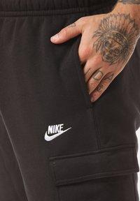Nike Sportswear - CLUB PANT - Pantalones cargo - black - 4