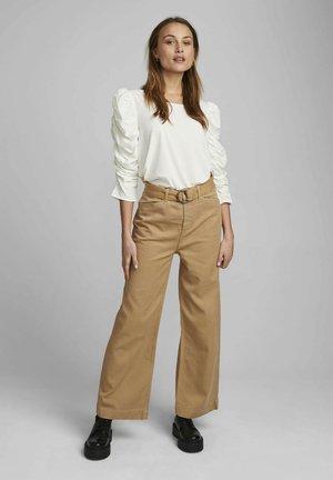 NUCASSAVA  - Trousers - tannin
