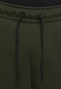 Nike Sportswear - Tracksuit bottoms - sequoia/black - 5