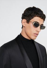 Alexander McQueen - Sunglasses - gold-coloured/grey - 1