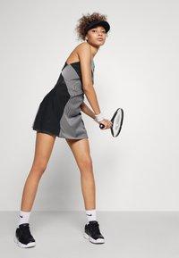Nike Performance - DRESS - Sports dress - black/white - 3