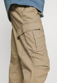 Carhartt WIP - JOGGER COLUMBIA - Cargo trousers - sand - 3