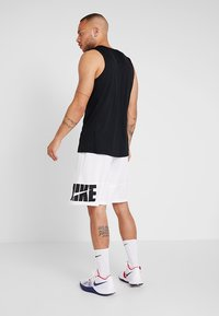 Nike Performance - CROSSOVER - Funktionströja - black/white - 2