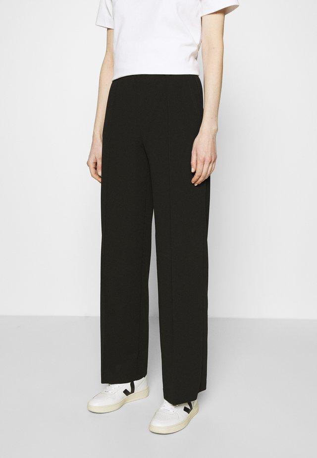 GENE PANTS - Pantalon classique - black