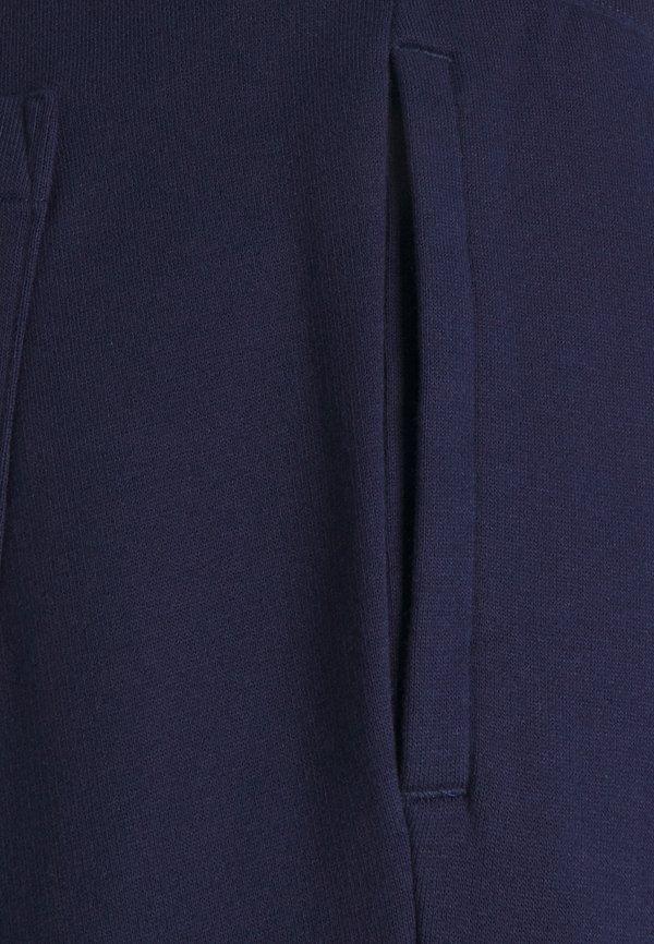 Polo Ralph Lauren MAGIC - Spodnie treningowe - cruise navy/granatowy Odzież Męska LTOA