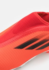 adidas Performance - X SPEEDFLOW.3 FIRM GROUND UNISEX - Moulded stud football boots - red - 5