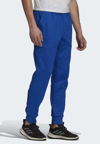 adidas Performance - MUST HAVES STADIUM TRACKSUIT BOTTOMS - Pantalones - blue - 3
