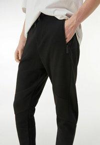 Bershka - Pantalon de survêtement - black - 3