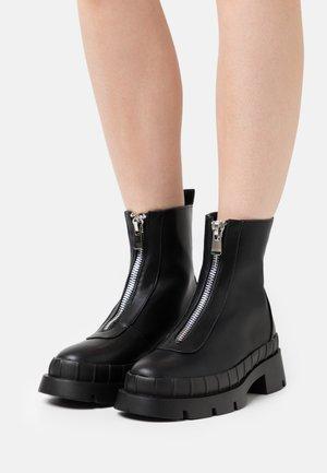 ANNYA - Platform ankle boots - black