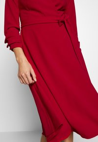 DKNY - RUCHED COVERED BUTTON SLEEVE FAUX WRAP FIT & FLARE - Jersey dress - scarlet - 5