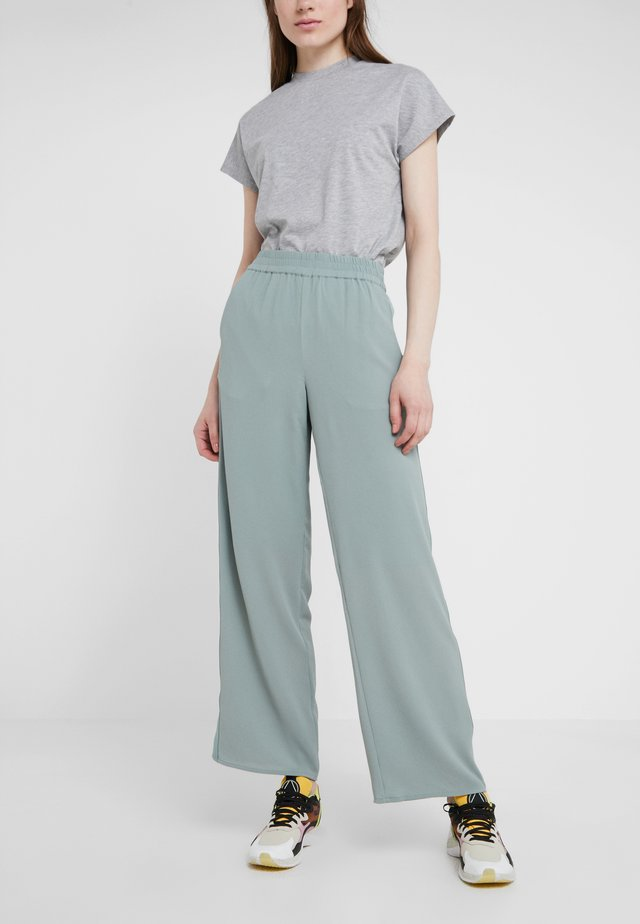 MOJA TROUSERS - Pantaloni - teal