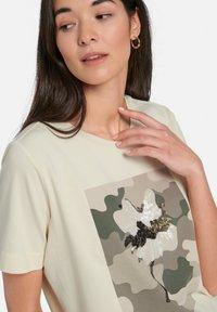 MARGITTES - Print T-shirt - offwhite/multicolor - 4